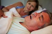 Man Keeping Woman Awake In Bed With Snoring