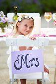 Bridesmaid Enjoying Meal At Wedding Reception