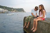 picture of boy scout  - A young boy and girl fishing in the sea with a fishing rod - JPG