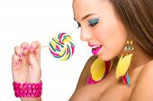 Colorful fashion model with lollipop and colorful accessories