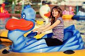 Teenage girl having fun in water park