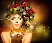 Christmas Winter Woman with Miracle in Her Hand. Fairy. Beautiful New Year and Christmas Tree Holida