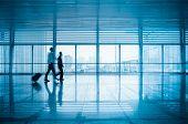 Passengers Motion Blur In Modern Corridor