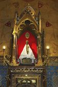 Wooden Black Madonna inside of church of Notre Dame in Rocamadour, France