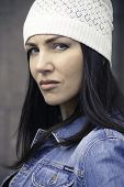 Portrait Of Pensive Girl In Jeans Jacket And Knitted Hat