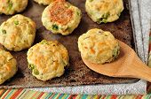 stock photo of patty-cake  - Baked potato patties with turkey cheese and peas on a baking tray - JPG