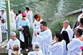 Yardenit, Israel - January 21: Baptism of Christian pilgrims in the holy waters of the Jordan River