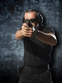 Man shooting hand gun