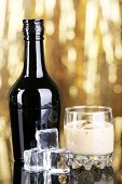 image of bailey  - Baileys liqueur in bottle and glass on golden background - JPG