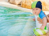 Adorable baby in swimming pool
