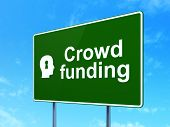 Business concept: Crowd Funding and Head With Keyhole