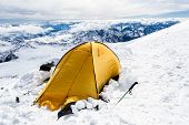stock photo of sochi  - Expedition camping in tent on Mount Elbrus trail to the top Mountain landscape in autumn or winter in Caucasus Mountains i Russia and Georgia view from Elbrus - JPG