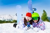 Happy young couple in ski masks lying together