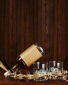 Glasses With Ice For Whiskey And Bottle On Wooden Background.