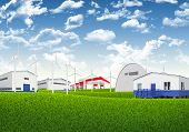 Blue sky, green grass and industrial area