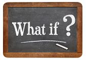 What if question  on a vintage blackboard isolated on white