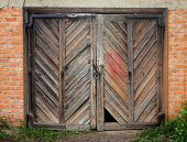 stock photo of outhouses  - This is Old wooden weathered barn door - JPG