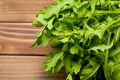 fresh arugula leaves on old wooden table