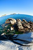 Summer landscape of rocky sea coast. Japan sea. Fish-eye lens.