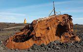Iceland. Reykjanes Peninsula. Rusted Vessel And Volcanic Ground. Lighthouse.