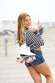 Woman Roller Skater Smiling With Thumbs Up