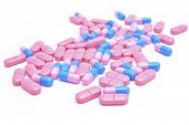 Blue and pink pills isolated on white