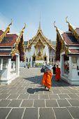 BANGKOK - APRIL 18: Buddhist monks visiting Grand Palace on April 18, 2014 in Bangkok, Thailand. The