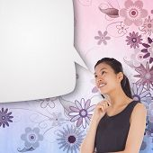 Thinking businesswoman with speech bubble against digitally generated girly floral design