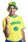Attractive Guy With Brazilian Jersey Laughing And Hat