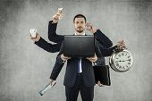 stock photo of multitasking  - Octopus in Business - JPG