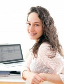 Portrait Of Young Smiling Business Woman At Work