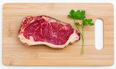 fresh marbled meat on a wooden hardboard
