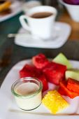 Delicious breakfast with tropical fruits and fresh yogurt