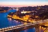 Porto Cityscape Portugal at dusk with Dom Luiz bridge