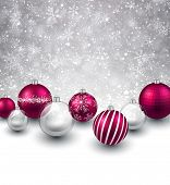 Winter background. Fallen defocused snowflakes. Christmas magenta balls. Vector.