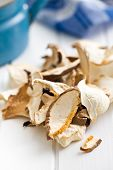 dried mushrooms on white table
