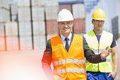 Male workers walking in shipping yard