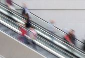 People traveling on escalator taking with slow shutter speed to show movement