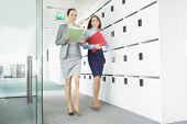 Blurred view of businesswomen walking in office