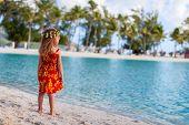 Little girl wearing Polynesian dress at beach on Bora Bora