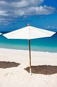 Chairs and umbrella on a beautiful Caribbean beach