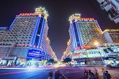 FUZHOU, CHINA - JUNE 16, 2014: Bayiqi Street at night. The street is the oldest shopping district in the city.