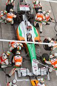 Sutil pits for tires at the Malaysian F1