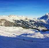 People On Ski  And Snowboards On Winter Sport Resort In Swiss Alps