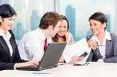 Businesspeople brainstorming in office