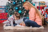 Mom and daughter waiting for Christmas