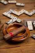 Cuban Cigar On Table With Domino Game