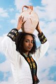 Young Ethiopian woman carrying a jug or pitcher