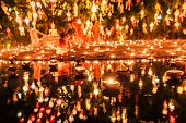 Floating Lantern With Monk And Buddha Image In Thai Temple