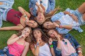 group of teens saying silence